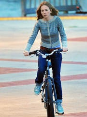 "Movie crews shoot a bike scene with Britt Robertson in ""Tomorrowland"" in 2013 at Titusville's Space View Park. Robertson is known from her TV work on the CW like ""Life Unexpected"" and the short-lived ""The Secret Circle."""