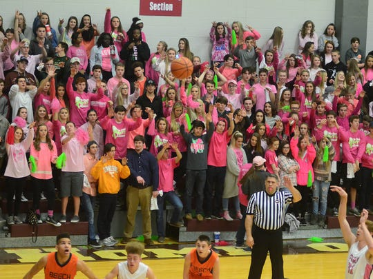 The Station Camp High student section raises their