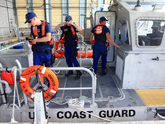 From left, Petty Officer Lance Harvey, Petty Officer Andrew Carlson and Petty Officer Gus Huddleston from the US Coast Guard prepare to patrol the Gulf of Mexico waters during spring break Wednesday, March 15, 2017, at Port Aransas.