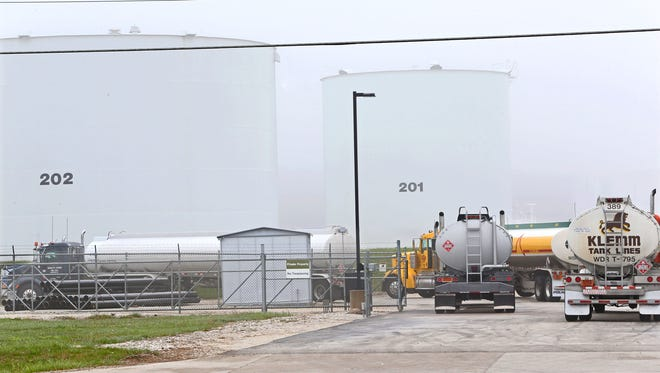 Fuel tankers from Green Bay-area truck companies wait in line to fill up at the US Oil fuel storage facility on N. 107 St. in Milwaukee after the indefinite closing of a  pipeline between the city and Green Bay.