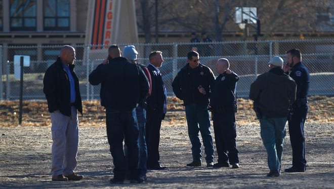 An incident command post is set up by local law enforcement and officials on Thursday, Dec. 7, 2017 at Aztec High School, inn Aztec, N.M.
