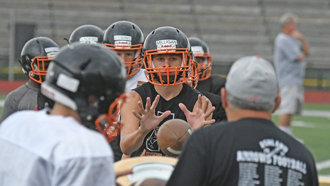 The Ashland Arrows receivers work on catching drills last season during practice at Community Stadium.