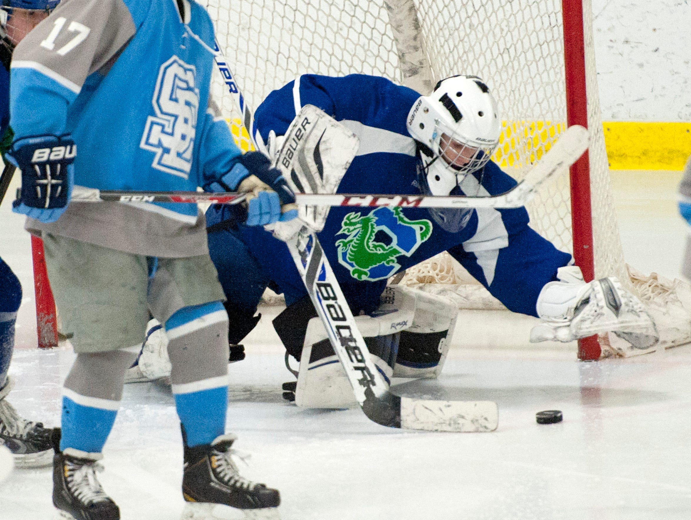 Colchester goalie Erik Swan reaches for the puck during