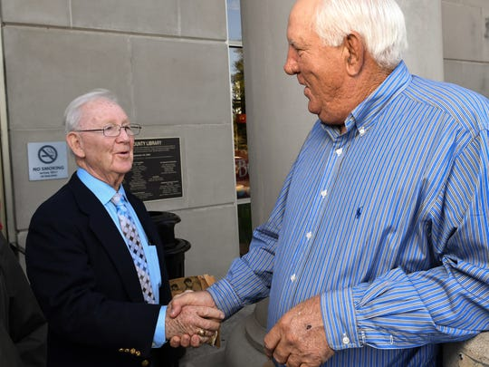 Bill Brissey, left, President of the Anderson Area Touchdown Club, shakes hands with guest speaker and former Clemson head football coach Danny Ford of Pendleton, before their last meeting for the season at the Anderson County Library in Anderson on Friday.