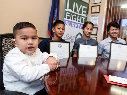 Four-year-old Braiden Manley, left, poses for a photo with siblings, from left, Mason Sanchez, 10; Masi Sanchez, 13, and Noah Quitugua, 18, after a donation ceremony at the office of Sen. Dennis Rodriguez Jr. in Tamuning on Dec. 23. The three siblings presented $500 to Manley, who has been diagnosed with leukemia. The trio also made another $500 donation to the Guam Cancer Care for Samantha Surban, a 9-year-old girl currently undergoing medical testing at the University of California, Los Angeles.