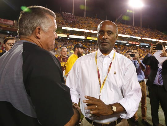 ASU coach Todd Graham shakes hands with Vice President of Athletics Ray Anderson after Saturday's win.