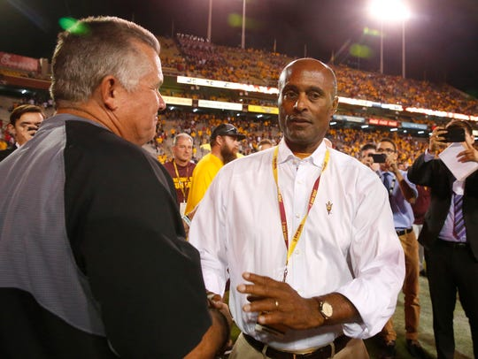 Arizona State head coach Todd Graham shake hands with