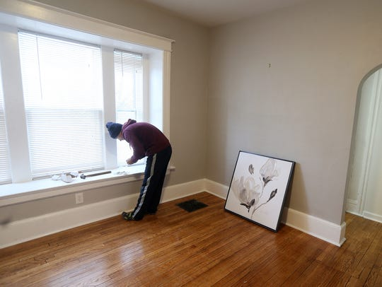 Mosal Maryal hangs art in a rental property on Barton