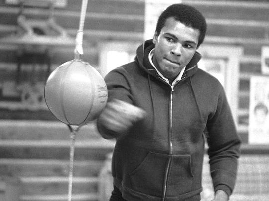 In this Jan. 10, 1974 file photo, Muhammad Ali punches a bag in his Deer Lake training camp where he was preparing for his rematch with Joe Frazier.