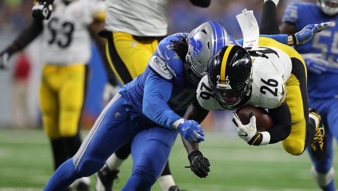 Lions defensive end Ziggy Ansah tackles Steelers running back Le'Veon Bell during the first quarter on Sunday, Oct. 29, 2017, at Ford Field.