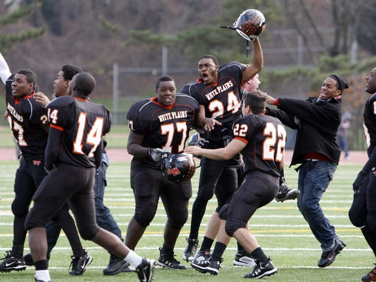 White Plains celebrate their 21-14 win over Stepinac