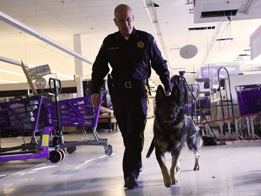 Sgt. Tim Scannell takes Odin, his canine partner, through a training in an abandoned supermarket on Wednesday March 14, 2018.