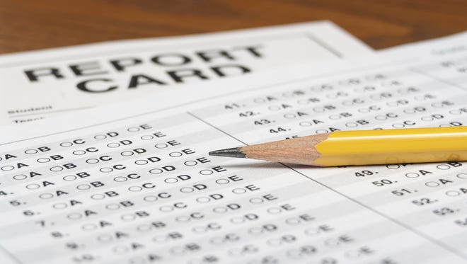 Standardized test with pencil and report card