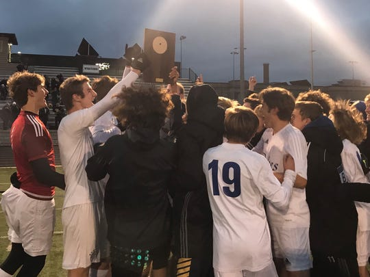 Whitefish Bay celebrates after winning 4-0 over Brookfield Central in a sectional final Oct. 28 at Shorewood High School.