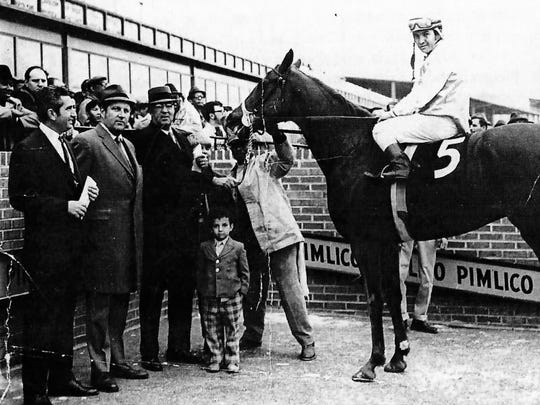 Frankie Lovato, Jr., pictured at 7 years old, at Pimlico Race Course.