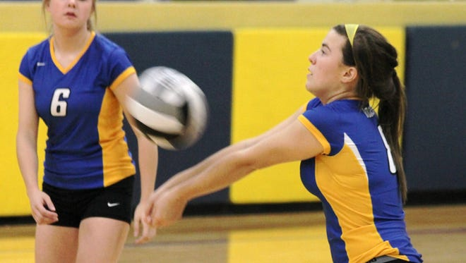 Clermont Northeastern junior Lindsay Wright has moved to libero this year to anchor the Lady Rockets' defense.