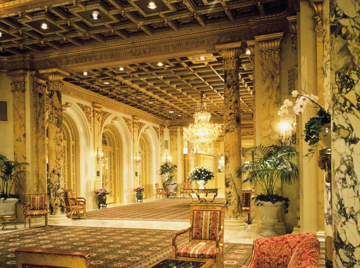 The lobby and sitting area at The Fairmont Copley Plaza in Boston invite guests to sink in and look up.
