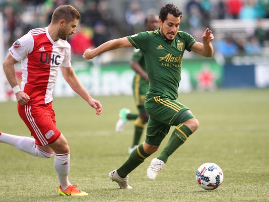Portland Timbers' Sebastian Blanco dribbles the ball next to a New England Revolution player during an MLS soccer match Sunday, April 2, 2017, at Providence Park in Portland, Ore. (Pete Christopher//The Oregonian via AP)