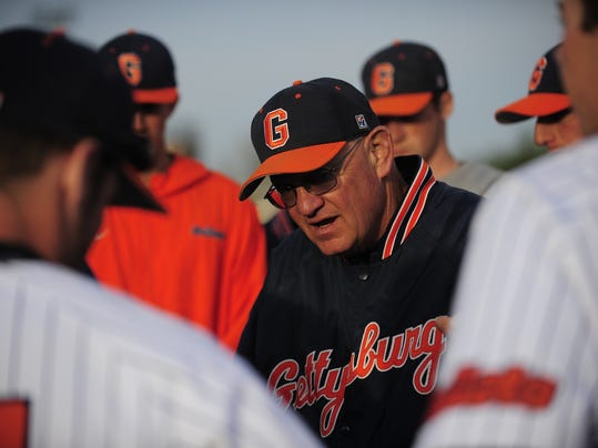 Coach John Campo talking to his players. Photo by David Sinclair