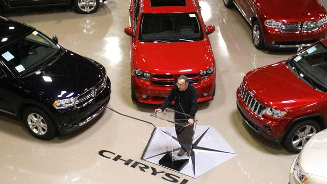 Sergio Marchionne addresses the media in 2011 at the automaker's Jefferson North Assembly Plant in Detroit.