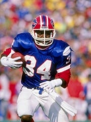 A file photo of Thurman Thomas in a previous game against the Patriots.