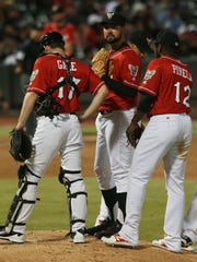 Teammates converged around El Paso starter Zach Lee