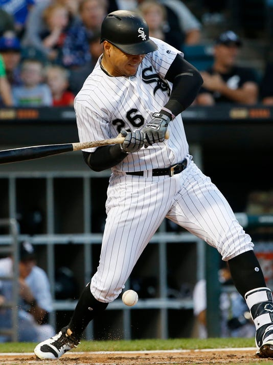 Chicago White Sox' Avisail Garcia is hit by a pitch from Kansas City Royals starter Ian Kennedy during the fourth inning of a baseball game Saturday, Aug. 12, 2017, in Chicago. (AP Photo/Nam Y. Huh)