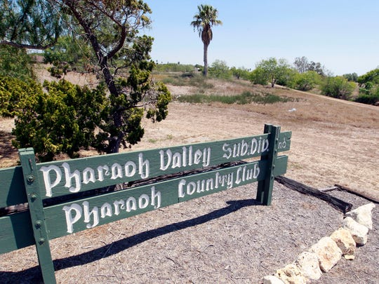 A luxury apartment complex and small cottage home are being proposed on the now closed Pharaoh Valley Golf course.