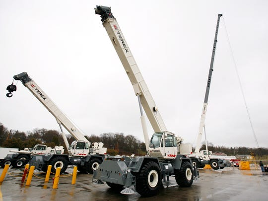 Cranes sit in the yard at the Terex Corp. plant in