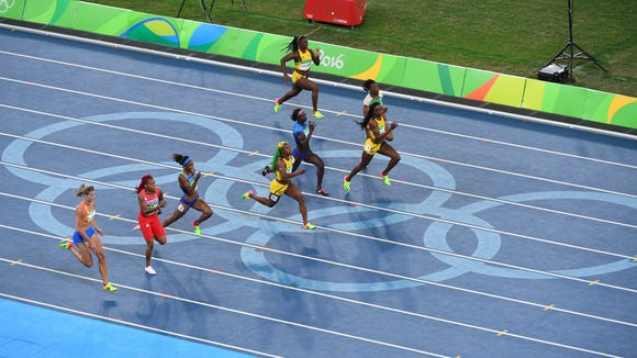 Aug 13, 2016; Rio de Janeiro, Brazil; Elaine Thompson (JAM) wins the women's 100m final at Estadio Olimpico Joao Havelange during the Rio 2016 Summer Olympic Games. Mandatory Credit: Jack Gruber-USA TODAY Sports   ORG XMIT: USATSI-GRP-822 ORIG FILE ID:  20160813_eml_usa_405.JPG