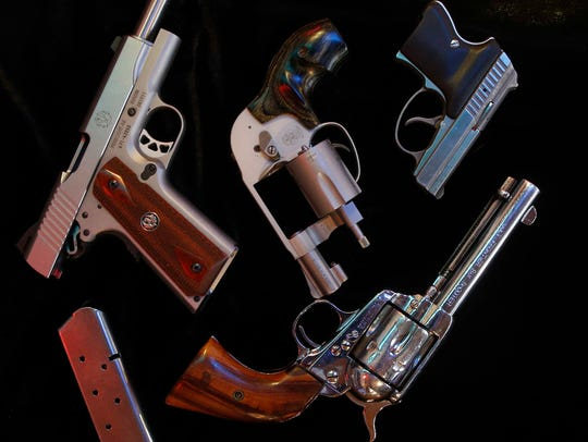 An assortment of handguns on display at The Pawn Shop