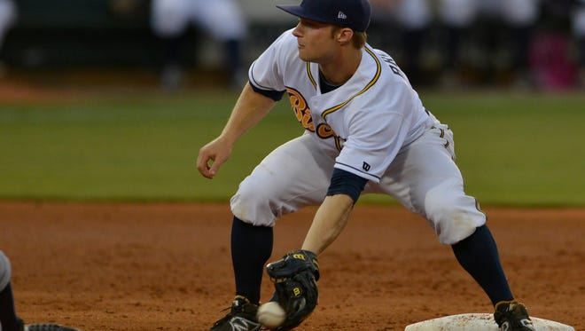 Montgomery Biscuits' Ryan Brett (1) catches the ball to make the out at second base on Mississippi Braves' Elmer Reyes (14) during their game at Riverwalk Stadium on Wednesday, June 4, 2014.