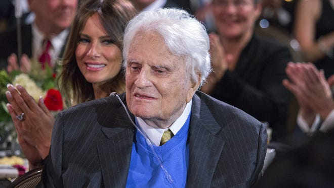 The Rev. Billy Graham attends his 95th birthday celebration in Asheville, N.C., on Nov. 7.
