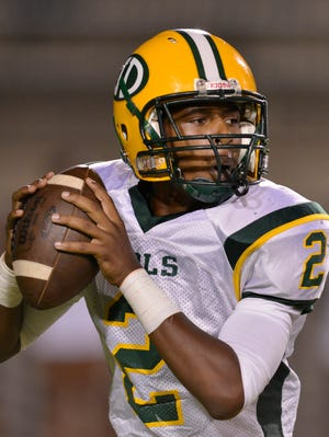 Jeff Davis' Zarron Haney (2) looks for a receiver during their game with Lanier at Cramton Bowl on Friday, Sept., 26, 2014.