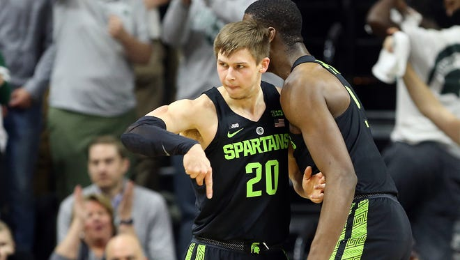 Matt McQuaid, right, reacts with teammate Jaren Jackson Jr., after scoring while being fouled during the first half of Friday's MSU win over Indiana at Breslin.