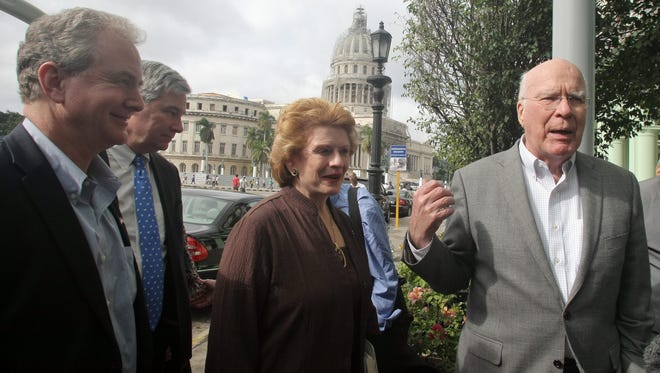 An American congressional delegation, led by Sen. Patrick Leahy, D-Vt., met with their Cuban counterparts in Havana on Monday, the first time since the United States and Cuba announced they would re-establish diplomatic relations. Joining Leahy were, from left, Democratic Sens. Chris Van Hollen of Maryland, Sheldon Whitehouse of Rhode Island and Debbie Stabenow of Michigan.