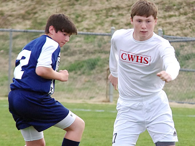 Tyler Turpin jets past a Culleoka player on his way to a Red Hawks goal. Creek Wood went on to win the game.