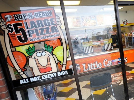 The Little Caesars logo features a pint-sized Roman emperor.