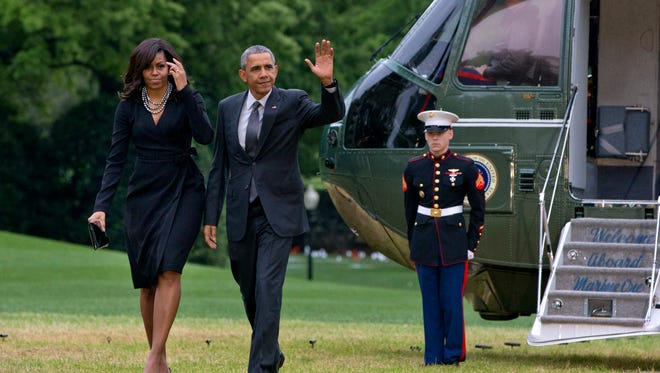 President Barack Obama waves as he and first lady Michelle Obama exit the Marine One helicopter on the South Lawn of the White House in Washington on May 5. The president will likely face a recession in the new term.