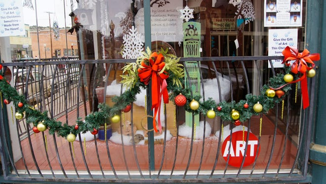 There are just two days left until Christmas, and downtown Silver City merchants such as The Raven's Nest Gallery have decorated their windows for the holiday and are ready for last minute shoppers. Don't forget Silver City Main Street gift certificates MainStreet Gift Certificates can be bought in $5, $10, and $25 denominations at the First American Bank main office located at 1609 N. Swan Street, Home Furniture located at 207 South Bullard in Historic Downtown Silver City, Gila Hike and Bike located at 103 E. College, or the Silver City Visitors Center located at the corner of Broadway and Hudson Streets.