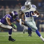 Dallas Cowboys running back Darren McFadden (20) carries the ball against Minnesota Vikings inside linebacker Eric Kendricks (54) in the second quarter at AT&T Stadium.