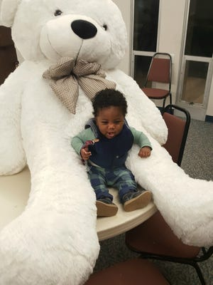 Baby Anthony was the lucky receiver of a 6-foot teddy bear, thanks to Unity in the Family, which works in conjunction with Prison Fellowship Ministry to deliver Christmas presents to children of incarcerated parents.