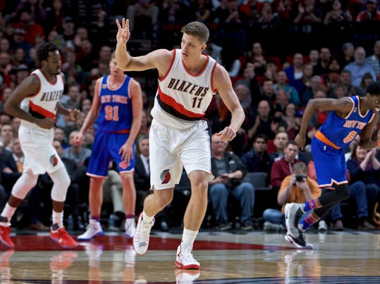 Portland Trail Blazers forward Meyers Leonard signels after making a 3-point basket against the New York Knicks during the first half of an NBA basketball game in Portland, Ore., Thursday, March 23, 2017. (AP Photo/Craig Mitchelldyer)