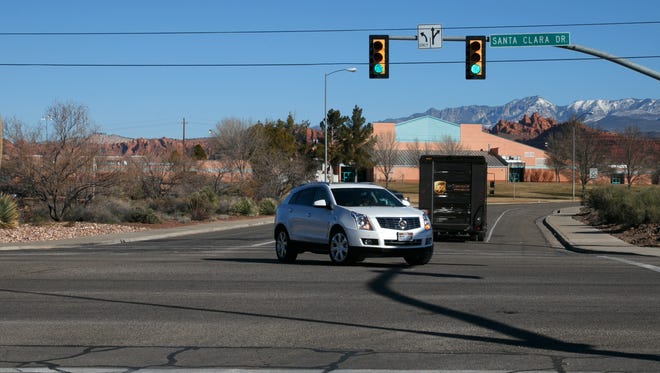 Cars turn on to Sunset Blvd. in front of Snow Canyon Middle School in this Spectrum file photo. A student at the school was taken into custody on Tuesday after police say they discovered texts that suggested that a shooting at the school might be planned for Wednesday.