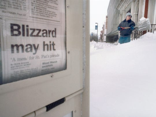 This headline quickly seemed dated as a man shovels several feet of snow from a York sidewalk in 1993.