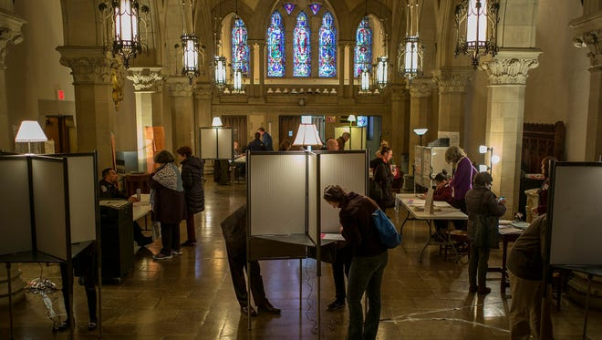 Voters cast their ballots at the Old South Church polling place in Boston on March 1, 2016.