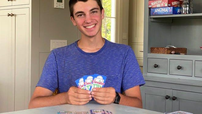 Harrison Brooks, 17, of Lincoln, Vermont, inventor of ElevatorUp, a face-to-face card game, sits in his family's kitchen on July 28, 2020.