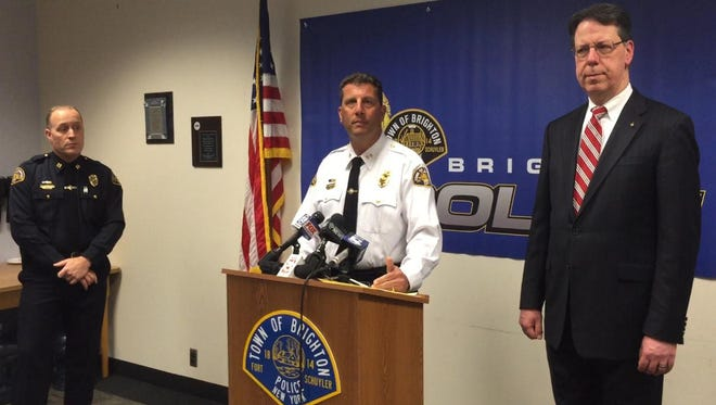 Brighton Police Chief Mark Henderson, center, discusses fatal train accident, joined by Capt. Dave Catholdi, left, and Supervisor William Moehle.