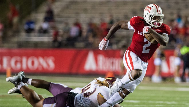 Cajuns wide receiver Al Riles (2), shown here breaking away from tacklers during a 2015 win over Texas State at Cajun Field, may return from an ankle sprain to play Saturday.