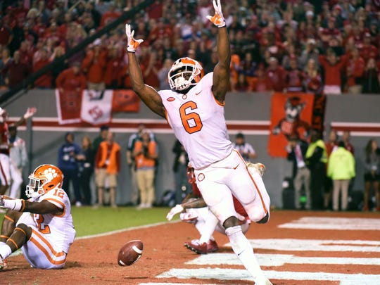 Clemson Tigers linebacker Dorian O'Daniel (6) reacts after a pass breakup during the second half against the North Carolina State Wolfpack at Carter-Finley Stadium.